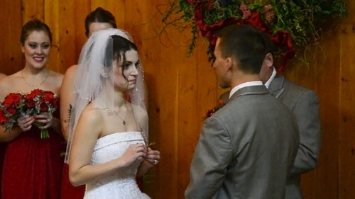 Nick and Jackie face each other and say their vows.