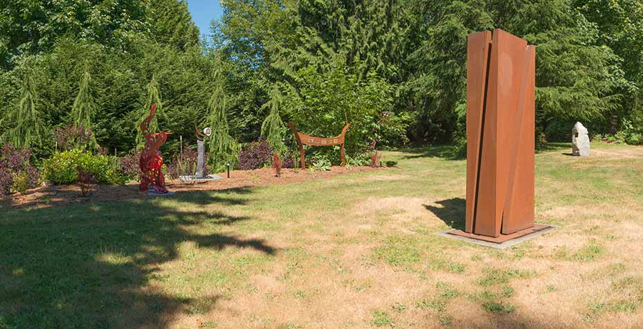 The Matzke outdoor art gallery on Camano island featuring statues of many different types.