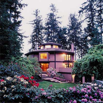 The Eagle's Nest Bed and Breakfast in the evening with trees all around.